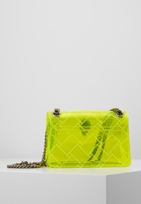 Kurt Geiger London - TRANSPARENT MINI KEN - Across body bag - yellow