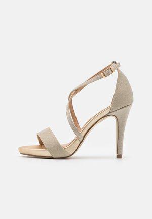 Sandaler med høye hæler - gold