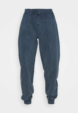 ACID WASH JOGGER - Tracksuit bottoms - denim blue