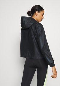 Puma - TRAIN WARM UP JACKET - Training jacket - black - 2