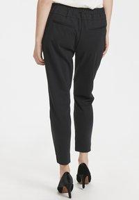 Cream - ANETT PANTS - Trousers - pitch black - 2