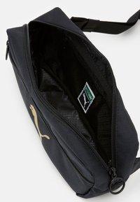 Puma - ORIGINALS WAIST BAG - Bum bag - black/gold - 2