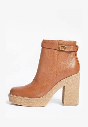 PEGGEY - Classic ankle boots - braun