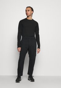 Nike Golf - NOVELTY PANT - Trousers - black - 1