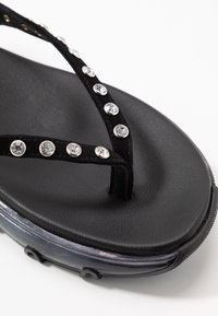Toral - Sandaalit nilkkaremmillä - black - 2