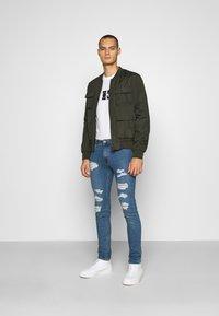 Calvin Klein Jeans - SMALL CENTER BOX TEE - Print T-shirt - bright white - 1
