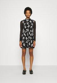 Calvin Klein Jeans - FLORAL DRESS - Day dress - black - 0