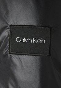 Calvin Klein - MULTI QUILT WADDED JACKET - Light jacket - white - 2