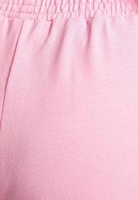 Bershka - Tracksuit bottoms - pink - 5