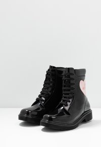 Love Moschino - RAIN LOVE - Lace-up ankle boots - black - 4