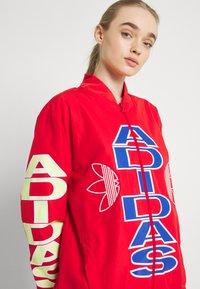 adidas Originals - WINDBREAKER - Training jacket - vivid red - 3