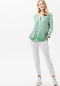BRAX - STYLE MARON - Trousers - white - 1