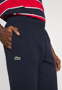 Lacoste - Tracksuit bottoms - navy blue - 4