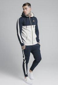 SIKSILK - CUT AND SEW BORG ZIPTHROUGH HOODIE - Zip-up hoodie - navy/snow - 1