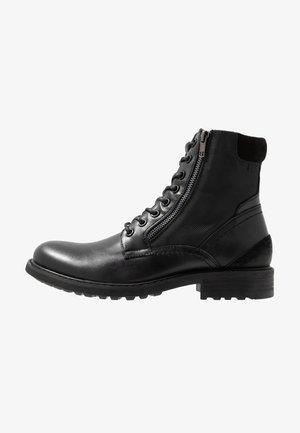 SIDEBAR - Šněrovací kotníkové boty - black