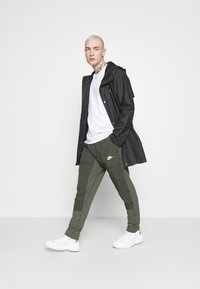 Nike Sportswear - PANT - Træningsbukser - twilight marsh/newsprint/ice silver/white - 1
