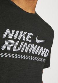 Nike Performance - MILER  - Print T-shirt - black/white - 5