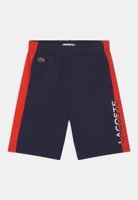 Lacoste - Tracksuit bottoms - navy blue/redcurrant bush - 0
