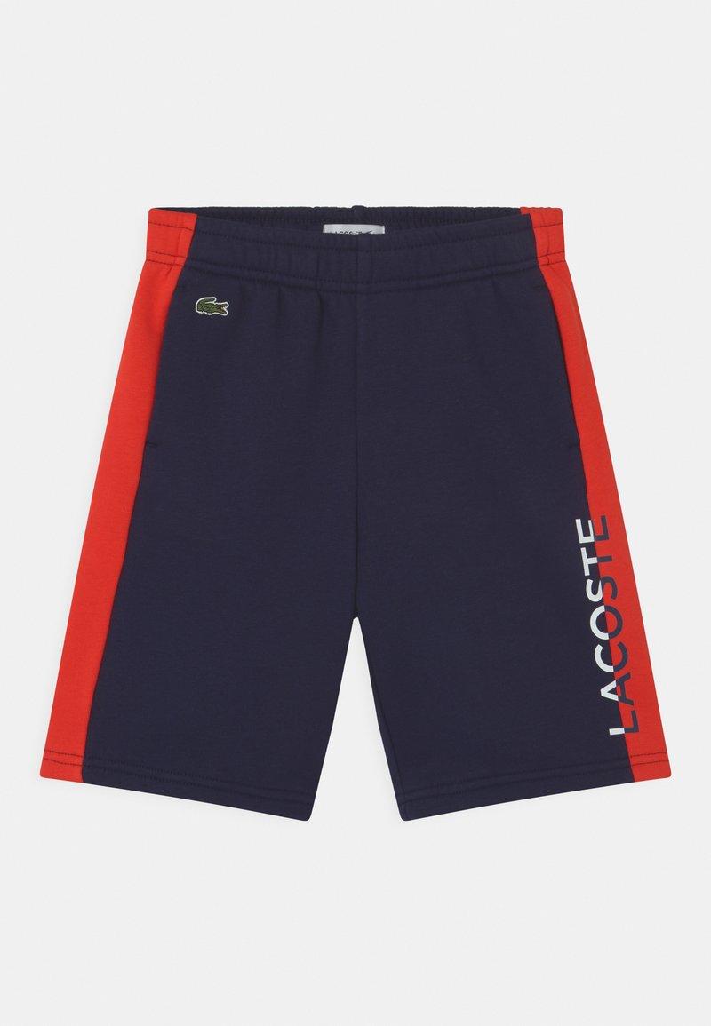 Lacoste - Tracksuit bottoms - navy blue/redcurrant bush