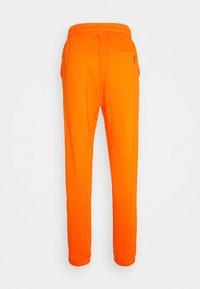 YOURTURN - Teplákové kalhoty - orange - 1