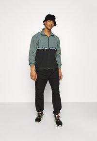 adidas Originals - SLICE - Training jacket - black/blue oxide - 1