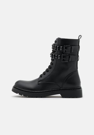 Lace-up ankle boots - soft nero