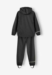 Name it - NKNDRY RAIN SET UNISEX - Rain trousers - black - 1