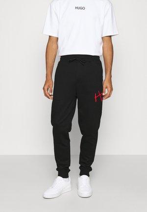 DARTINI - Jogginghose - black