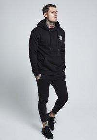 SIKSILK - Pantaloni sportivi - black - 1