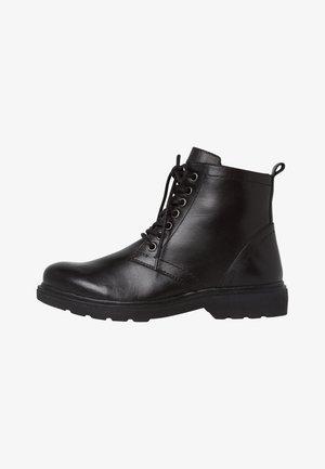 STIEFELETTE - Platform ankle boots - black nappa
