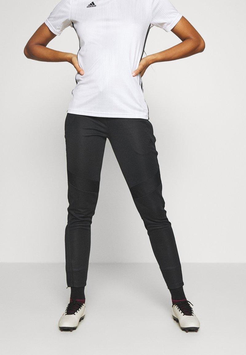 adidas Performance - TIRO - Tracksuit bottoms - black