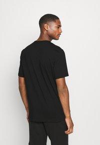 Calvin Klein Underwear - ONE GRAPHIC TEE CREW NECK - Pyjama top - black - 2