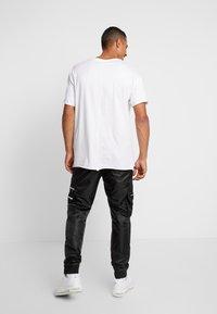 Golden Equation - RIGA  - Cargo trousers - black - 2