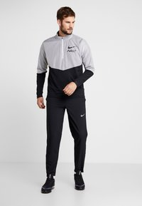 Nike Performance - RUN STRIPE PANT - Tracksuit bottoms - black/silver - 1