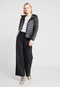 Didriksons - MALVINA WOMEN'S PANTS - Outdoor trousers - black - 1