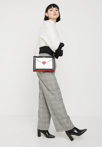 LYDC London - Across body bag - white/black - 1