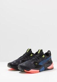Puma - LQDCELL OPTIC - Zapatillas de running neutras - black - 2