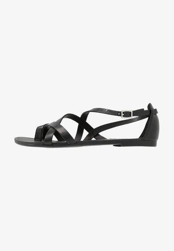 TIA - T-bar sandals - black