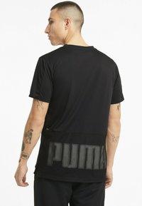 Puma - GRAPHIC  - Print T-shirt - puma black - 2