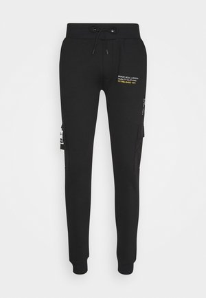 TECH - Tracksuit bottoms - jet black