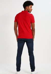 Selected Homme - SLHARO EMBROIDERY - Polo shirt - true red - 2
