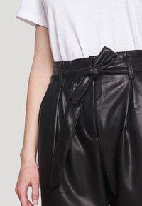 Miss Selfridge - PAPERBAG TROUSER - Trousers - black - 4