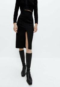 Uterqüe - Pouzdrová sukně - black - 0