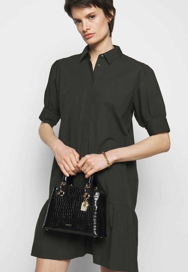 DKNY - TONI SATCHEL MINI SHINY EMBOSSED CROCO - Handbag - black/gold