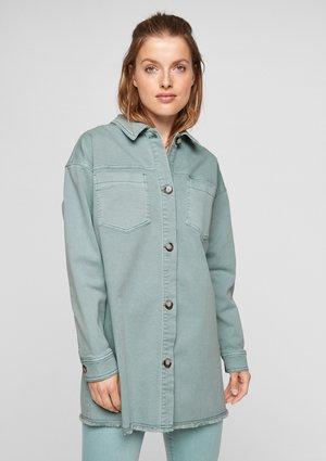 SURCHEMISE A FRANGES - Denim jacket - light green