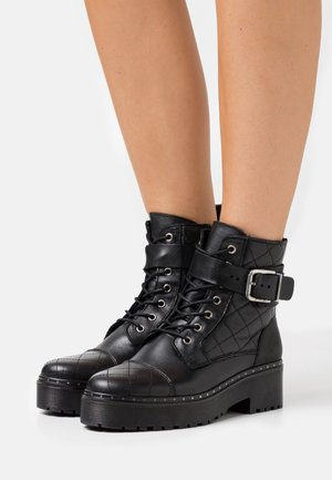 YASLINA QUILTED BOOTS - Platform ankle boots - black