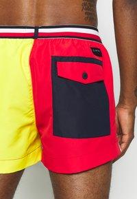 Tommy Hilfiger - DRAWSTRING - Swimming shorts - red - 1