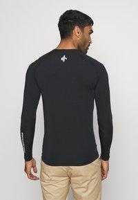 Cross Sportswear - ARMOUR - Koszulka sportowa - black - 2