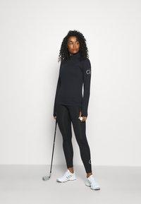 Calvin Klein Golf - VIBE HALF ZIP LAYERING - Long sleeved top - black - 1