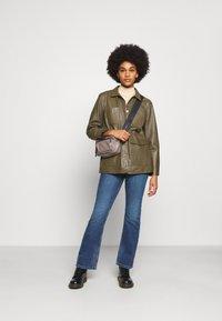 JDY - JDYNEWFLORA NEELA LIFE HGH FLARE  - Straight leg jeans - medium blue denim - 1